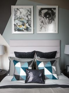 "A single black sequined throw pillow and silk pillows in a blue geometric pattern add interest and texture to the queen-size bed.  The bold wall treatment behind the headboard is a fun accent to this neutral space. ""It mimics a simplified version of the pattern I saw in the rug,"" says interior designer Lindsay Pumpa. ""It's very angular and geometric. I added the teal in there to add some color."" #HGTVUrbanOasis"