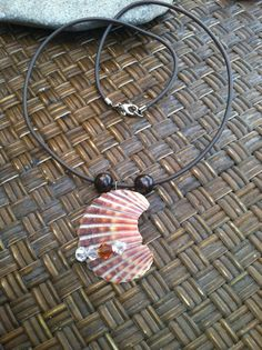wire shell jewelry | Wire Wrapped Shell Necklace with Swarovski Crystals, Reclaimed Wood ...