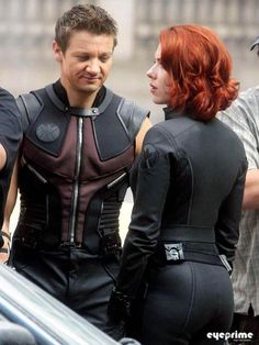 Is Jeremy Renner checking out Scarlett Johansson's cleavage?  ; )