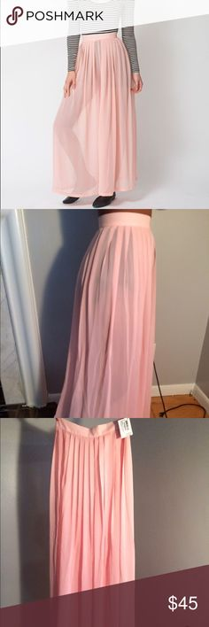 American Apparel Chiffon Wide Leg Pant Model is wearing a size Small. Hidden zip closure. Wide Leg. Pleated sheer construction. 100% polyester. Never worn, new with tag! American Apparel Pants Wide Leg