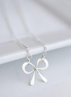 Sterling Silver Bow Necklace is a great minimal accessory. A sweet silver bow necklace perfect for any occasion.