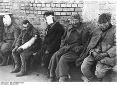 Warsaw Uprising, Oct 1944: Wounded Polish POWs await their fate -- either death on the spot or concentration camp.