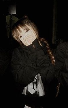 Ariana Grande covering her mouth with her hands. she is acting surprised.:).