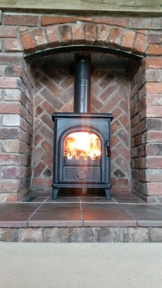 Alpha 1 Multi Fuel Stove and Brick Fireplace