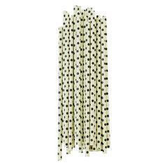 A pack of 25 paper straws by home goods brand Miss Étoile, vintage design and very Paris, the green straws with black dots are a perfect cocktail decoration.
