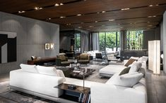 Minotti company showroom. Connery seating system, Rodolfo Dordoni design; Fynn armchair and coffee table, GamFratesi design; Torii armchairs, nendo design. #minotti #company #showroom #gamfratesi #rodolfodordoni #nendo L Shaped Living Room, Outdoor Projects, Outdoor Decor, Video Wall, Living Spaces, Living Rooms, Showroom, Armchair, Table