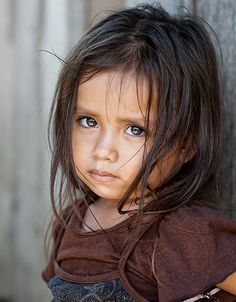 Those eyes! Looks like my younger sister sponsor child and I wanna hug her :)