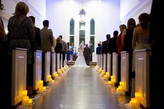 LED Candles and White Petals down the aisle! Beautiful!