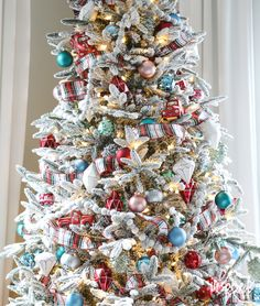 See how Inspired by Charm decorated his Fun, Festive, and Flocked Christmas Tree. Plus, tips and tricks for decorating a flocked Christmas tree. Flocked Christmas Trees Decorated, Creative Christmas Trees, Christmas Trees For Kids, Christmas Tree Design, Colorful Christmas Tree, Christmas Tree Themes, Merry Little Christmas, Vintage Christmas Ornaments, Simple Christmas