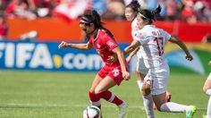 Canada's Jonelle Filigno (L) vies with China's Gu Yasha during a Group A football match between Canada and China at Commonwealth Stadium during the opening match of the FIFA Women World Cup in Edmonton, Canada, on June 6, 2015. AFP PHOTO/GEOFF ROBINS