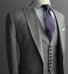 Suit, vest, purple tie. All I need is drink now.