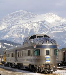 VIA Rail train with the Canadian Rockies in the background