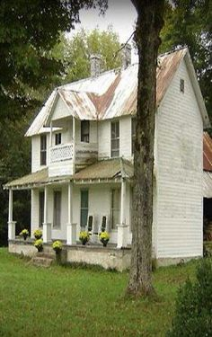 farmhouse.  I love the porch and balcony.