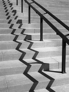 Andre Kertesz- I like how he took a simple railing and saw how how the shadow was. it made a really cool zigzag on the starts which makes the picture unique