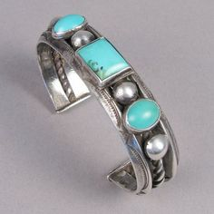 Silver cuff with three turquoise stones c 1920