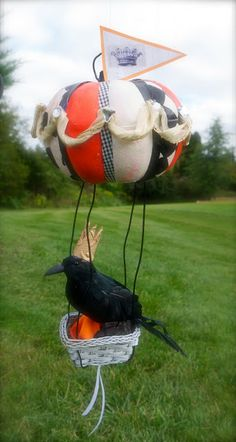 diy halloween pumpkin balloons with raven and crown up, up and away
