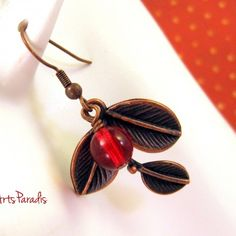 #Very #Cherry - #Copper #Earrings When I saw these #leaf charms I instantly thought of #cherries. The #vibrant #red glass bead is beautifully highlighted by the copper #colors surrounding it. A great pair to wear year round with everything from jeans to business suits! #handmade #jewelry #ArtsParadis