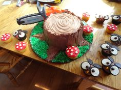 Our woodland forest Party! I made toad stool and owl cupcakes, and made a tree stump cake with chainsaw and all! I added edible acorns to the grass later on. I used layers of vanilla and chocolate cake with Bavarian cream in between the layers. Luv how this turned out!