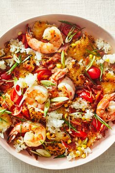 This one-pan recipe is a great use of leftover rice, though you can also use freshly cooked rice as long it's no longer hot. Crispy Rice With Shrimp, Bacon and Corn - NYT Cooking Corn Bacon Recipe, Corn Recipes, Fish Recipes, Seafood Recipes, Dinner Recipes, Cooking Recipes, Leftover Rice Recipes, Nytimes Recipes, Shrimp And Rice Recipes