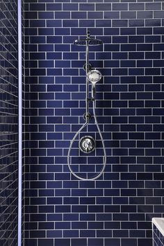 Blue Subway Tile In This Bathroom Shower Stall