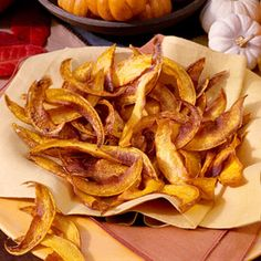 Pumkin Chips - Cut pumpkin into very thin slices with a vegetable peeler and deep fry until crisp.