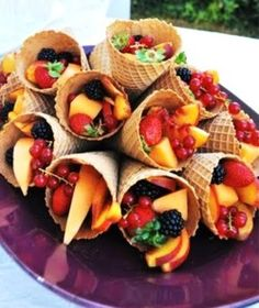 Fruit in a waffle cone - Yum! I would serve a hollowed out fruit bowl (cantelope, honeydew, pineapple) on the side so guests could add just a dollop of  mascarpone whipped cream!!!
