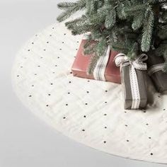 Add some new style to your traditional decor and mix up your Christmas decorations with the Quilted X Pattern Tree Skirt from Hearth & Hand™ with Magnolia. In white with an allover pattern of little black X's, this quilted tree skirt makes a fun change from typical red or holiday-themed Christmas tree skirts. It'll bring a modern touch to your Christmas decorating that you'll love using for years to come. <br><br>Celebrate the everyday with Hearth & Ha...