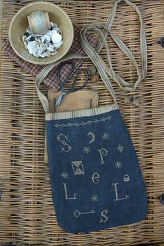 Stacy Nash Primitives Spells Sewing Pouch - Cross Stitch Pattern. Model stitched on 30 Ct. Gunmetal linen with Gentle Art Sampler threads. Stitch Count: 86 x 13
