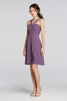 We love the artful draping and unexpected Y-neckline on this short mesh bridesmaid dress.  Y-neck halter bodice features elegant pleated detail with a short crinkle chiffon skirt.  Fully lined. Imported. Back zipper. Dry clean only.  Also available in Extra Length sizes as Style 2XLW10943.  To protect your dress, try our Non Woven Garment Bag.