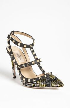 Golden pyramid studs glint on the caged straps of a crystallized leather pump with a slim heel and pointed toe. - This Valentino pump stopped me with it's price tag...$1,595