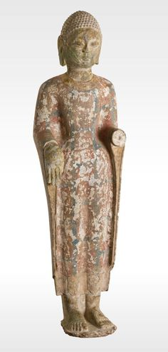 Title: Buddha. Artist: Unknown (Chinese). Art Movement: Chinese Southern and Northern Dynasties (420-589) - China. Materials/Techniques: Gilt limestone.
