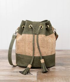 Magnolia Bucket Bag Cork Fabric Pattern - Introduction to Sewing with Cork Fabric.  Learn how to sew with cork as you make this bag. Drawstring bucket bag with cork tassels.