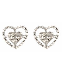 Vintage Heart Stud Earrings  Showcasing a classic symbol, these vintage heart stud earrings feature a unique twist on the icon. The piece includes a large, thin heart frame with a smaller heart that rests in the center. The center heart is covered in small diamonds, adding a gorgeous shine to this piece.  $33.00