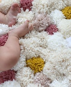 This would be fun as a photo prop! @tgreuel  DIY Bedside Pom Pom Rug | Say Yes