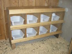 easy to clean nesting boxes. Cut the front edge so they don't roost on them. Instead of making wooden cubbies, I would just make a frame and add slats for the plastic tubs to slide into.