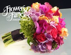 Flowers & Fancies bouquet of Hydrangea, orchids, roses, calla lilies, parrot tulips, and brezillia berries