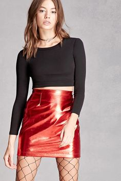 A structured faux leather mini skirt by Kikiriki™ featuring a sheeny design and a two-way zipper back.