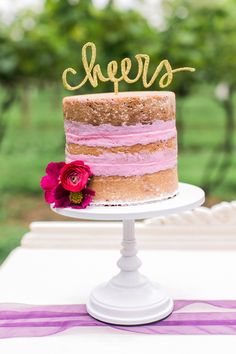 wedding cake with pink icing - photo by Alexis June Weddings http://ruffledblog.com/london-inspired-jewel-tone-shoot #weddingcake #cakes