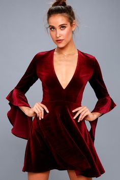 Take a twirl in the Wrapped in Luxe Burgundy Velvet Bell Sleeve Skater Dress! Soft and stretchy velvet falls from a plunging V-neckline, into three-quarter, ruffled bell sleeves. Darted bodice and fitted waist sit above a full skater skirt. Hidden side zipper.