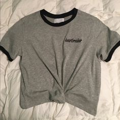 Kendall and Kylie Heartbreaker croptop Kendall and Kylie heartbreaker tee Slightly cropped Size: Medium                                                   Only time worn was for picture shown above  #pacsun #kyliejenner #kendallandkylie #croptop #heartbreaker #blackandwhite #new PacSun Tops Crop Tops