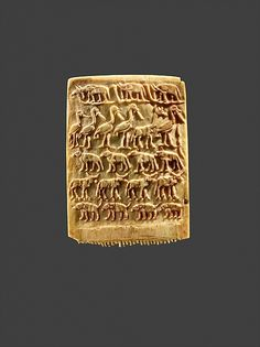 Hair Comb Decorated with Rows of Wild Animals Period: Predynastic, Late Naqada III Date: ca. 3200–3100 B.C. Geography: From Egypt Medium: Ivory