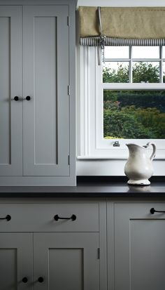 Plain English cupboards painted in Marston & Langinger interior eggshell. http://www.marston-and-langinger.com/News/blog-article/Colour-of-the-Week-Cobble-Grey