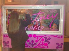 Sign-in on a decorated mirror that you can then use in your room from Dazzling Parties.