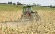 Tractors in the field are very common in Spring to work the ground and plant the crops and in the Fall to harvest. They can also be seen in the winter months carrying a big round bale of hay to the livestock. This tractor is pulling a disc.