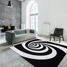 This FloorDecor USA 3D optical illusion rug makes it look and feel like a mesmerizing timelapse through a spiral hole in the floor. Trick your friends and guests who walk towards the rug to make them feel like they are going to fall into a never ending spiral hole in the center of the floor that leads to the unknown. #rugs