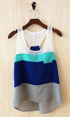 This tank combines feminine and playful, high and low style with a nice loose drape perfect for the summer heat or for layering