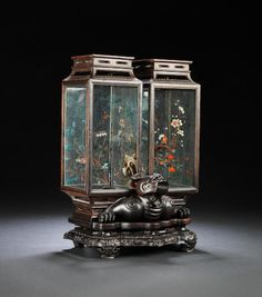A ZITAN AND GLASS DOUBLE LANTERNLate centuryThe rectangular lanterns each with glass panels painted on the sides with various flowers and foliage, set within and locked in place on carved a mythical beast, all above an ornately carved waisted stand. x cm Old Lanterns, Chinese Lanterns, Chinese Painting, Chinese Art, Chinese Architecture, Chinese Ceramics, Types Of Art, Glass Panels, Asian Art