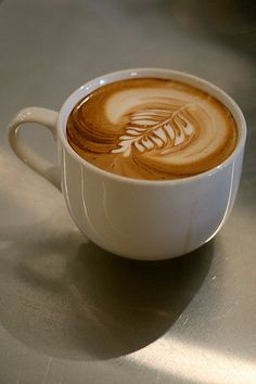 One of our first latte art pours . . . mmmmm   baristacoffees.com/shop has the best tasting gourmet coffees at the {ch