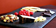 Espresso BellaVitano® with mixed nuts, wafer crackers, dark chocolate and raspberries
