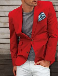 Shop this look on Lookastic: https://lookastic.com/men/looks/red-blazer-grey-crew-neck-t-shirt-white-jeans-blue-pocket-square/1294 — Red Cotton Blazer — Grey Crew-neck T-shirt — Blue Paisley Silk Pocket Square — White Jeans